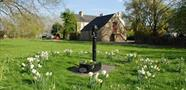 The old pump on the village green in Freeland (photo courtesy of www.freelandoxon.co.uk)